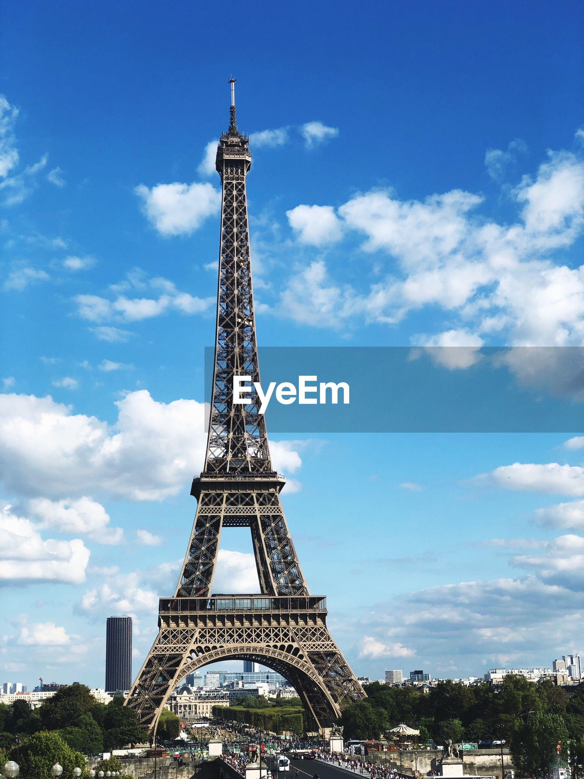 Eiffel tower in city against sky