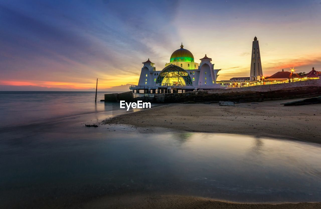 sky, water, architecture, building exterior, sunset, built structure, place of worship, religion, spirituality, dome, sea, nature, belief, building, travel destinations, cloud - sky, no people, travel