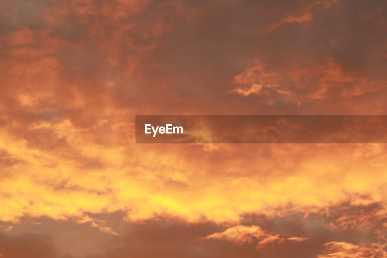 cloud - sky, beauty in nature, sky, sunset, nature, scenics, backgrounds, low angle view, dramatic sky, orange color, majestic, cloudscape, tranquility, sky only, tranquil scene, outdoors, no people, idyllic, full frame, awe, day