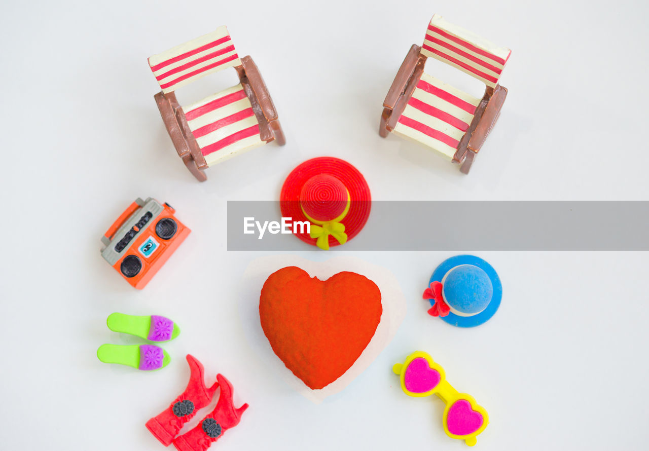 High angle view of colorful toys on white background