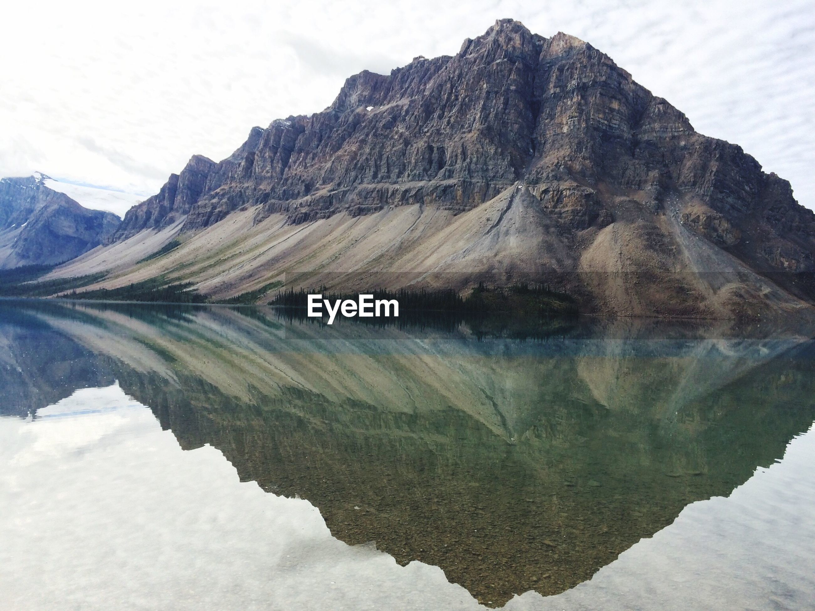 Reflection Of Rocky Mountains In Calm Lake