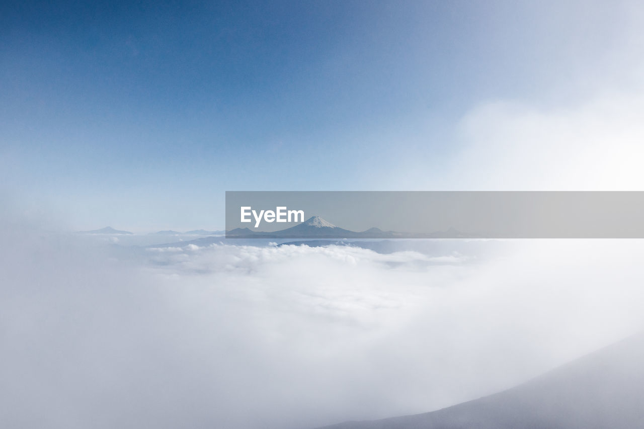 sky, cloud - sky, beauty in nature, scenics - nature, mountain, tranquility, tranquil scene, day, nature, no people, outdoors, idyllic, environment, cloudscape, non-urban scene, mountain range, dreamlike, white color, fluffy, landscape, above, mountain peak