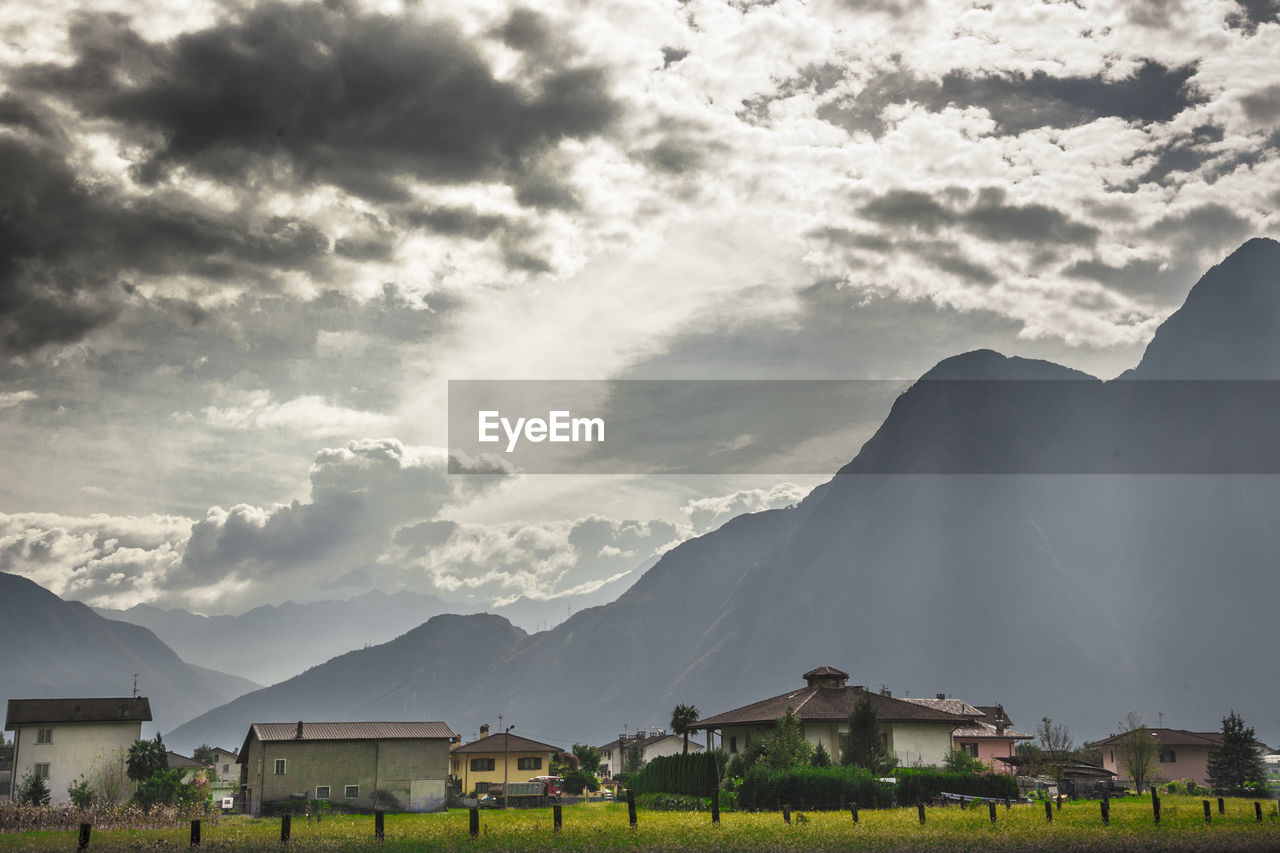 built structure, architecture, mountain, building exterior, house, sky, mountain range, scenics, cloud - sky, nature, tranquility, beauty in nature, no people, day, landscape, outdoors, tree