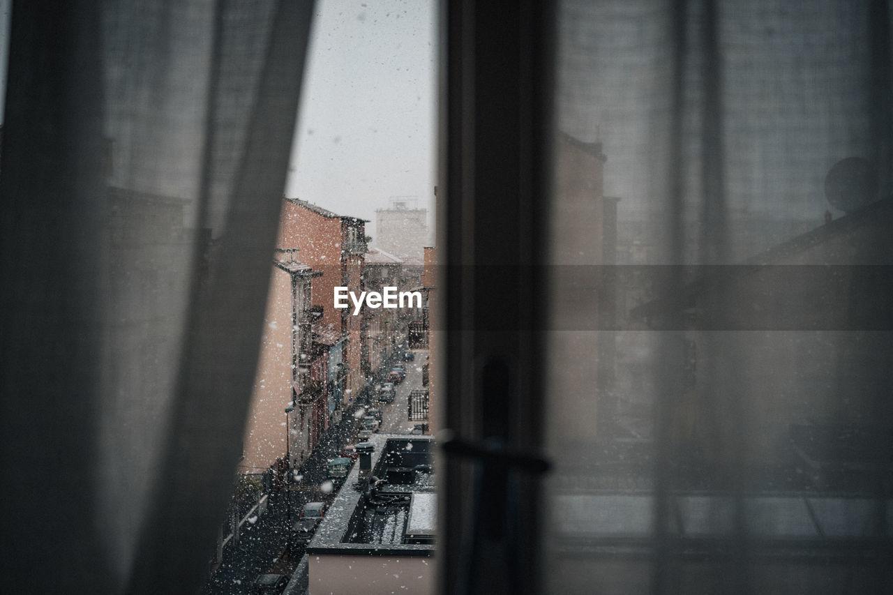 HIGH ANGLE VIEW OF WINDOW ON WALL