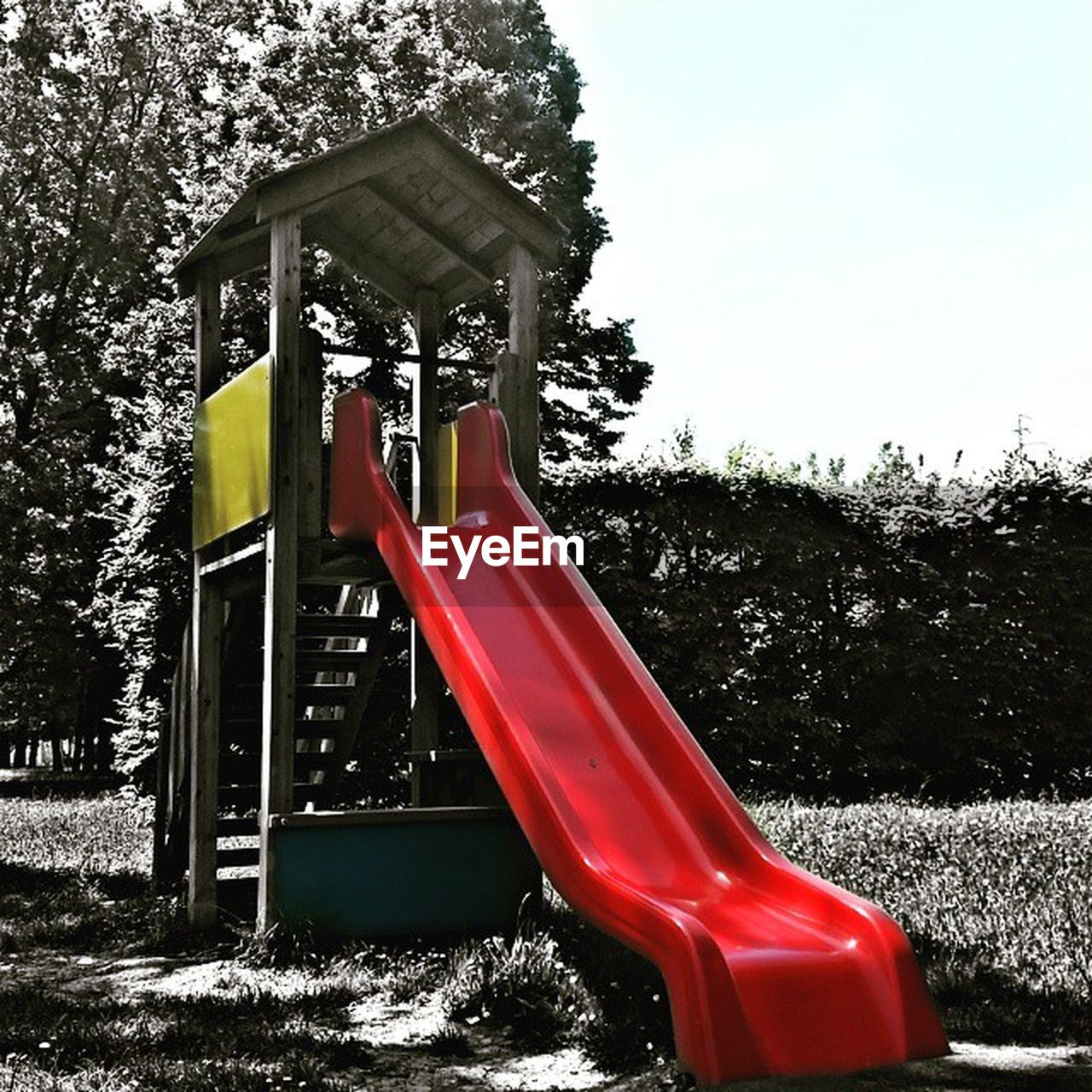 tree, playground, slide, slide - play equipment, outdoor play equipment, red, childhood, park - man made space, no people, outdoors, day, nature, sky, water slide, close-up
