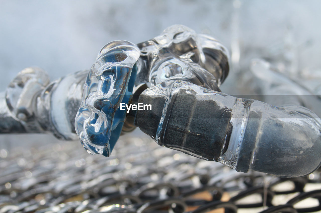 Close-up of frozen metallic pipe