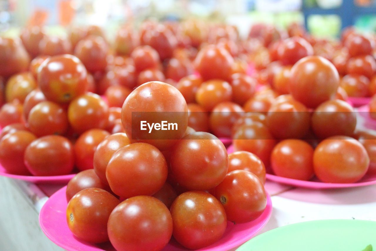 Close-up of tomatoes in plate at market