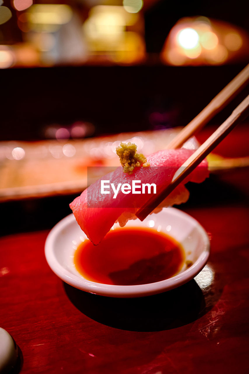 food and drink, food, focus on foreground, freshness, close-up, chopsticks, table, restaurant, indoors, asian food, japanese food, seafood, healthy eating, plate, wellbeing, still life, business, ready-to-eat, sushi, no people, sashimi, crockery