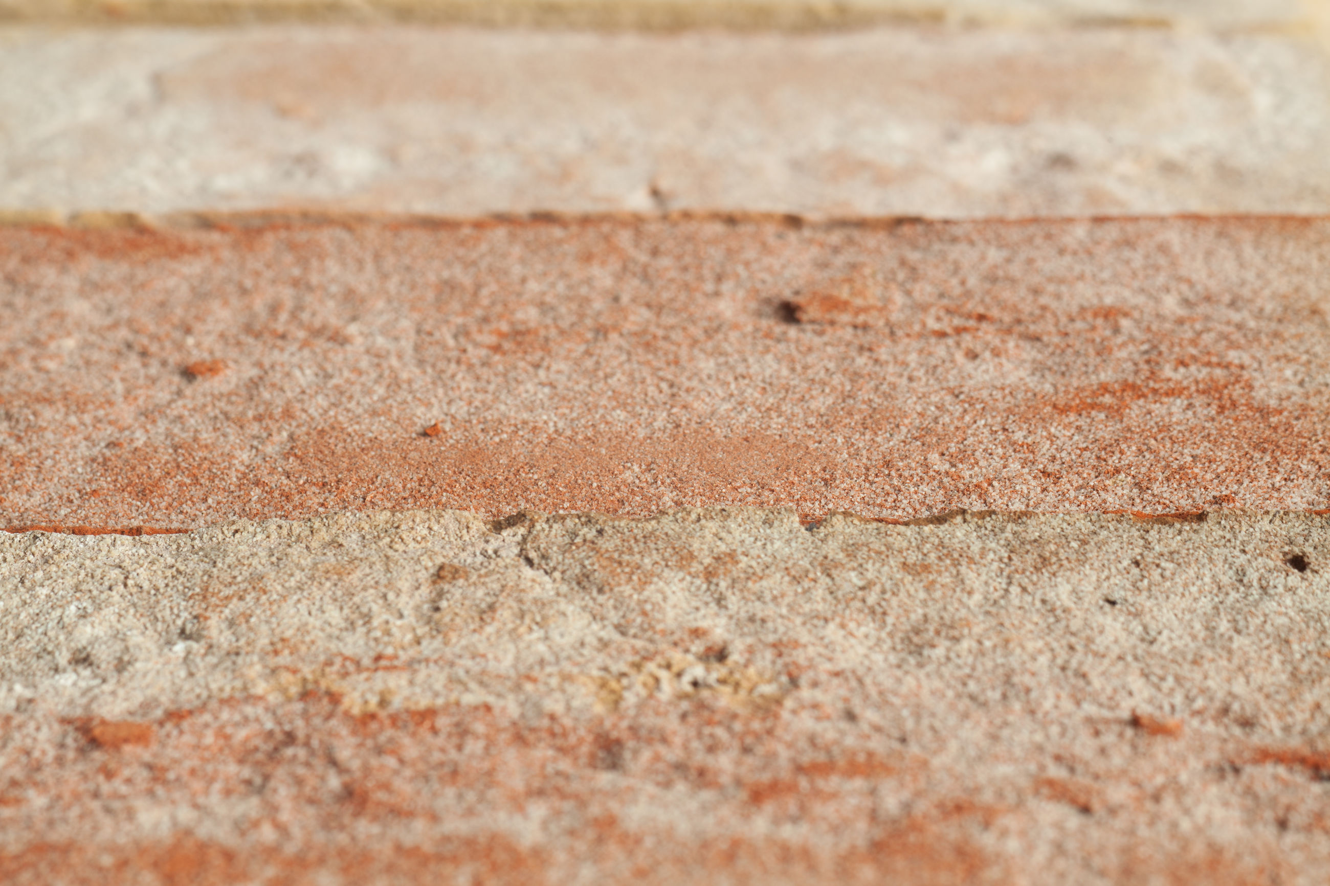 textured, backgrounds, no people, full frame, close-up, selective focus, pattern, day, brown, outdoors, rough, sand, high angle view, land, wall - building feature, surface level, flooring, concrete, built structure, wall