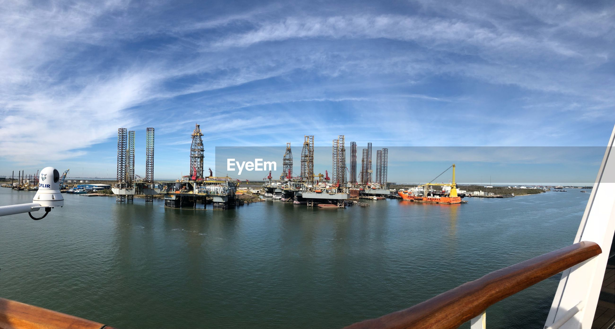 Fish-eye lens shot of commercial dock against sky