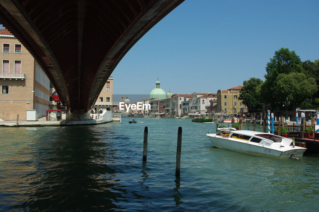 architecture, transportation, water, built structure, nautical vessel, bridge - man made structure, waterfront, mode of transport, connection, day, river, outdoors, building exterior, wooden post, nature, no people