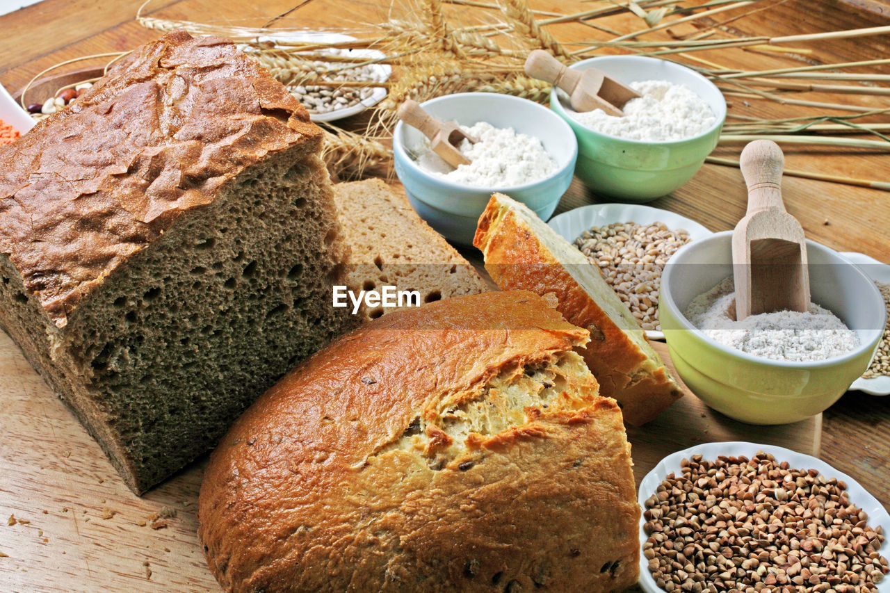 Close-Up Of Homemade Bread And Necessary Ingredients On Table