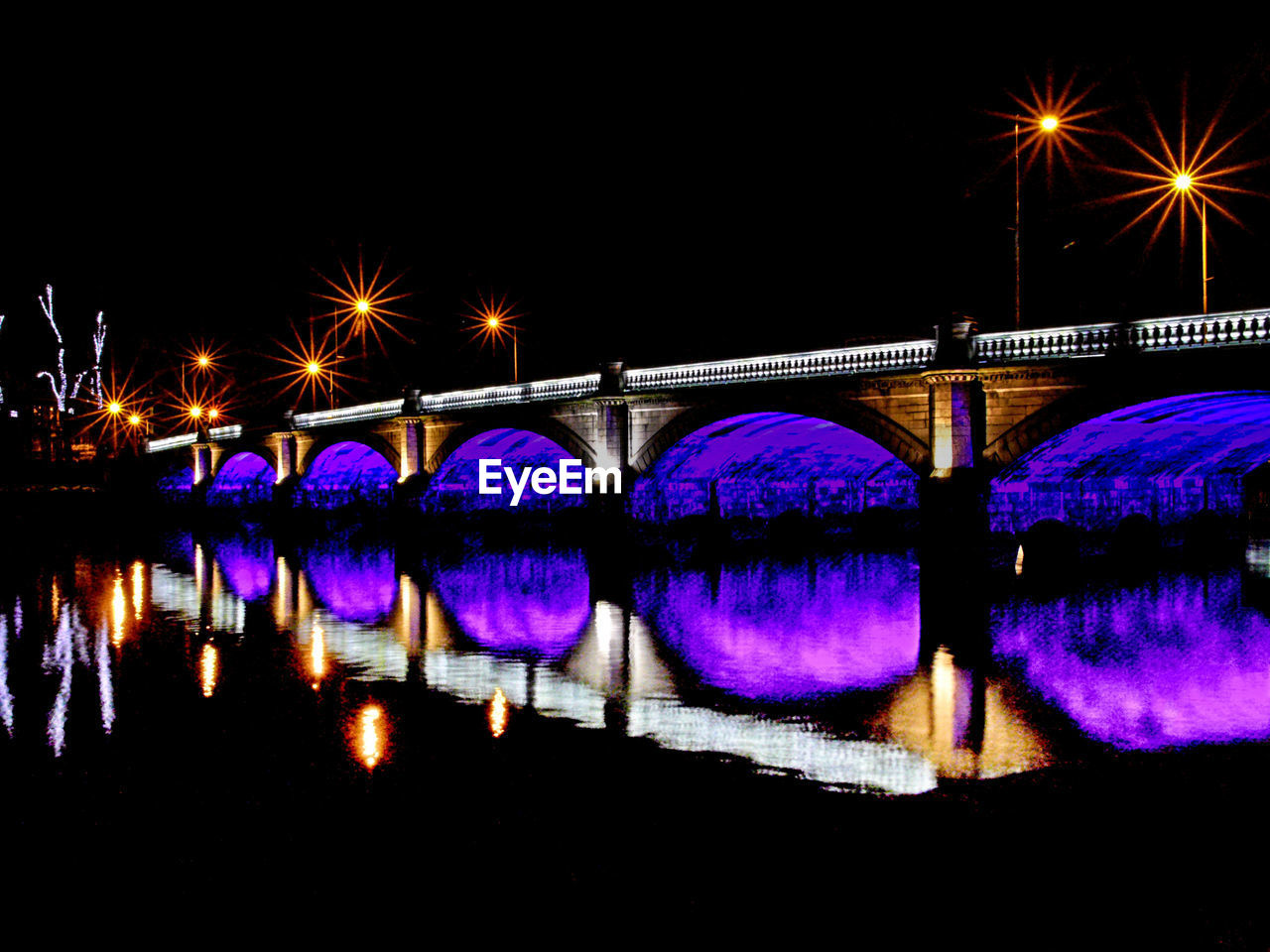 water, illuminated, reflection, night, bridge, connection, architecture, bridge - man made structure, built structure, river, nature, waterfront, travel destinations, sky, lighting equipment, city, no people, transportation, street light, arch, outdoors, light, arch bridge, purple