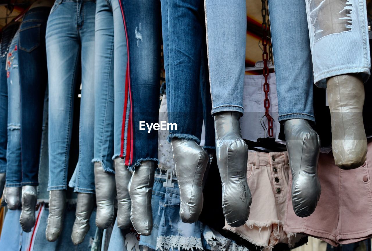 choice, variation, side by side, retail, market, large group of objects, people, jeans, in a row, for sale, day, low section, human body part, shoe, clothing, representation, market stall, collection, outdoors, retail display