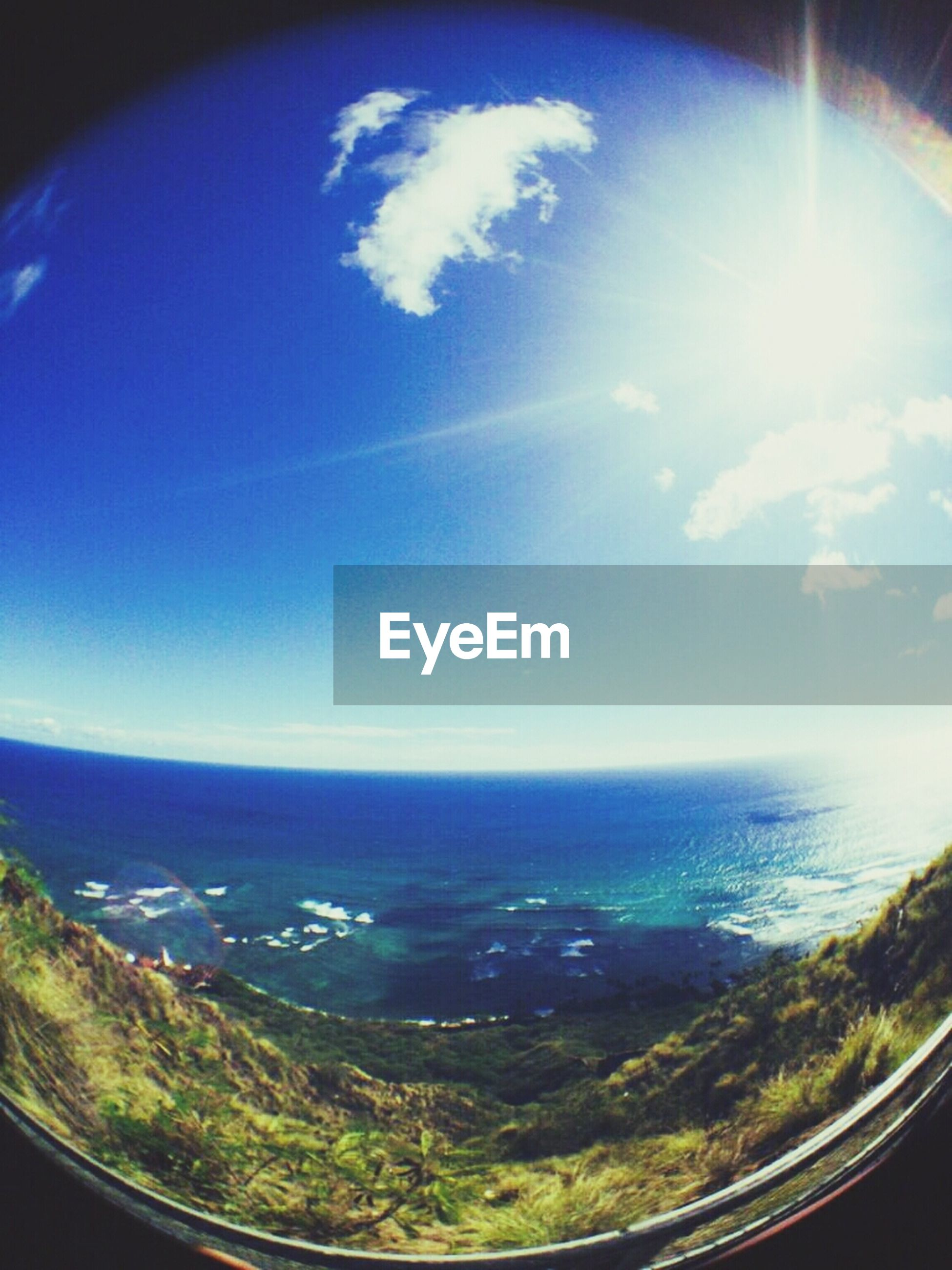 sea, horizon over water, blue, scenics, beauty in nature, sky, tranquil scene, water, tranquility, nature, transportation, fish-eye lens, aerial view, sunlight, sun, idyllic, cloud - sky, airplane, landscape, window