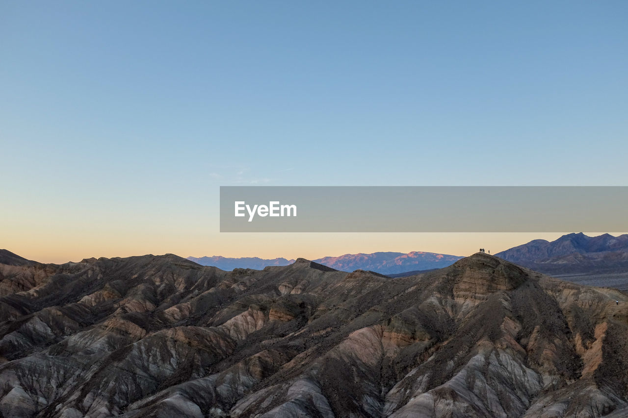 sky, scenics - nature, mountain, beauty in nature, tranquility, non-urban scene, tranquil scene, mountain range, landscape, rock, idyllic, copy space, nature, no people, environment, remote, rock - object, solid, clear sky, sunset, outdoors, arid climate, climate, formation, eroded, mountain peak