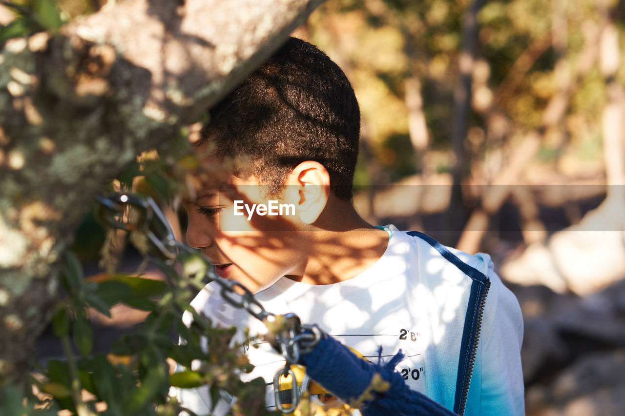 Close-up of boy by plants