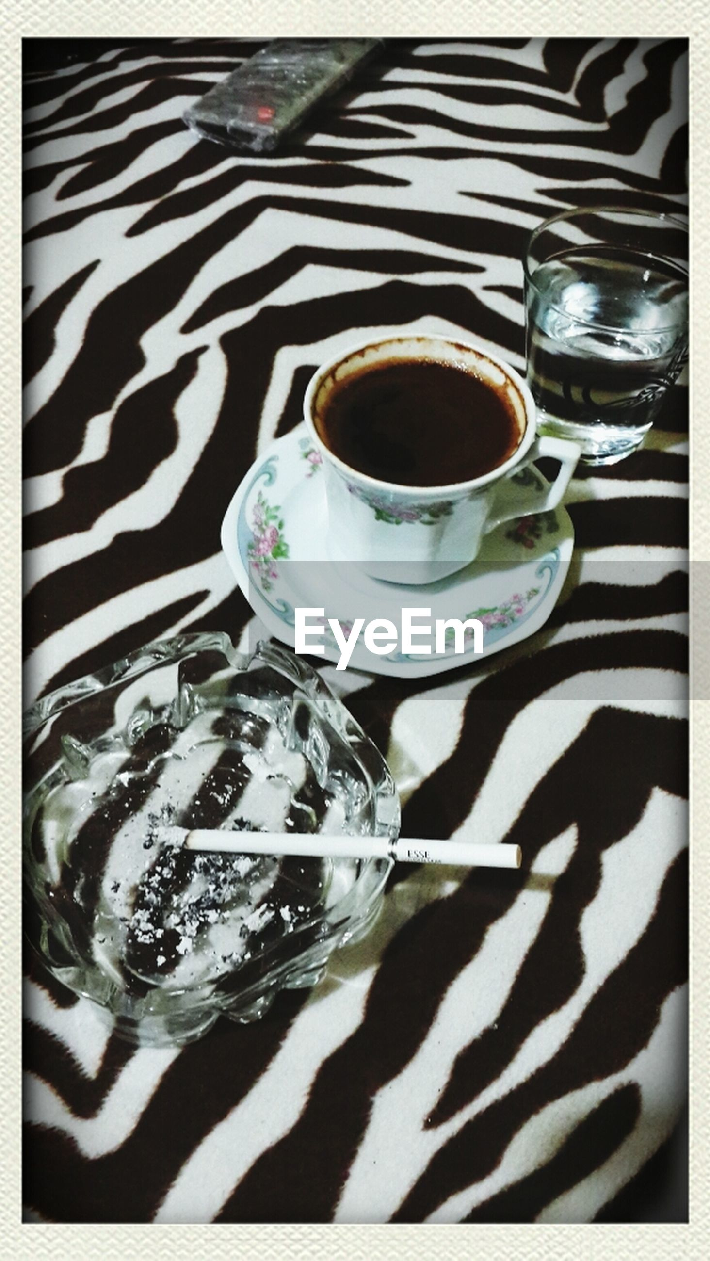 drink, food and drink, refreshment, indoors, table, still life, drinking glass, freshness, close-up, saucer, glass - material, coffee cup, high angle view, spoon, transparent, glass, coffee - drink, transfer print, auto post production filter, cup