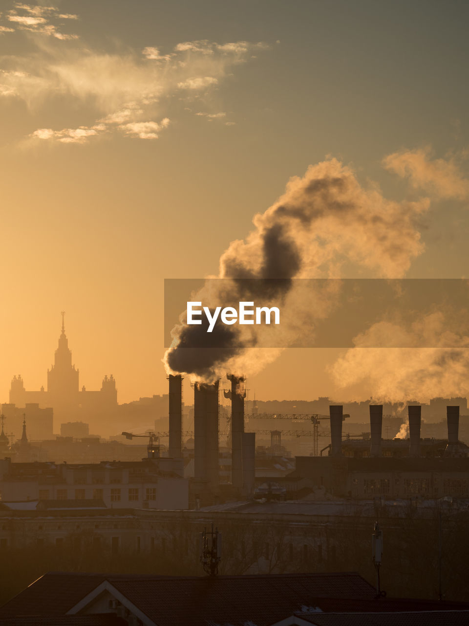 Smoke Emerging From Chimney Against Sky During Sunset