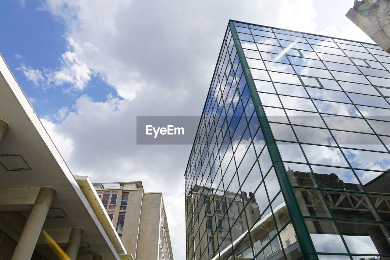 architecture, low angle view, modern, built structure, building exterior, sky, day, skyscraper, no people, outdoors, city