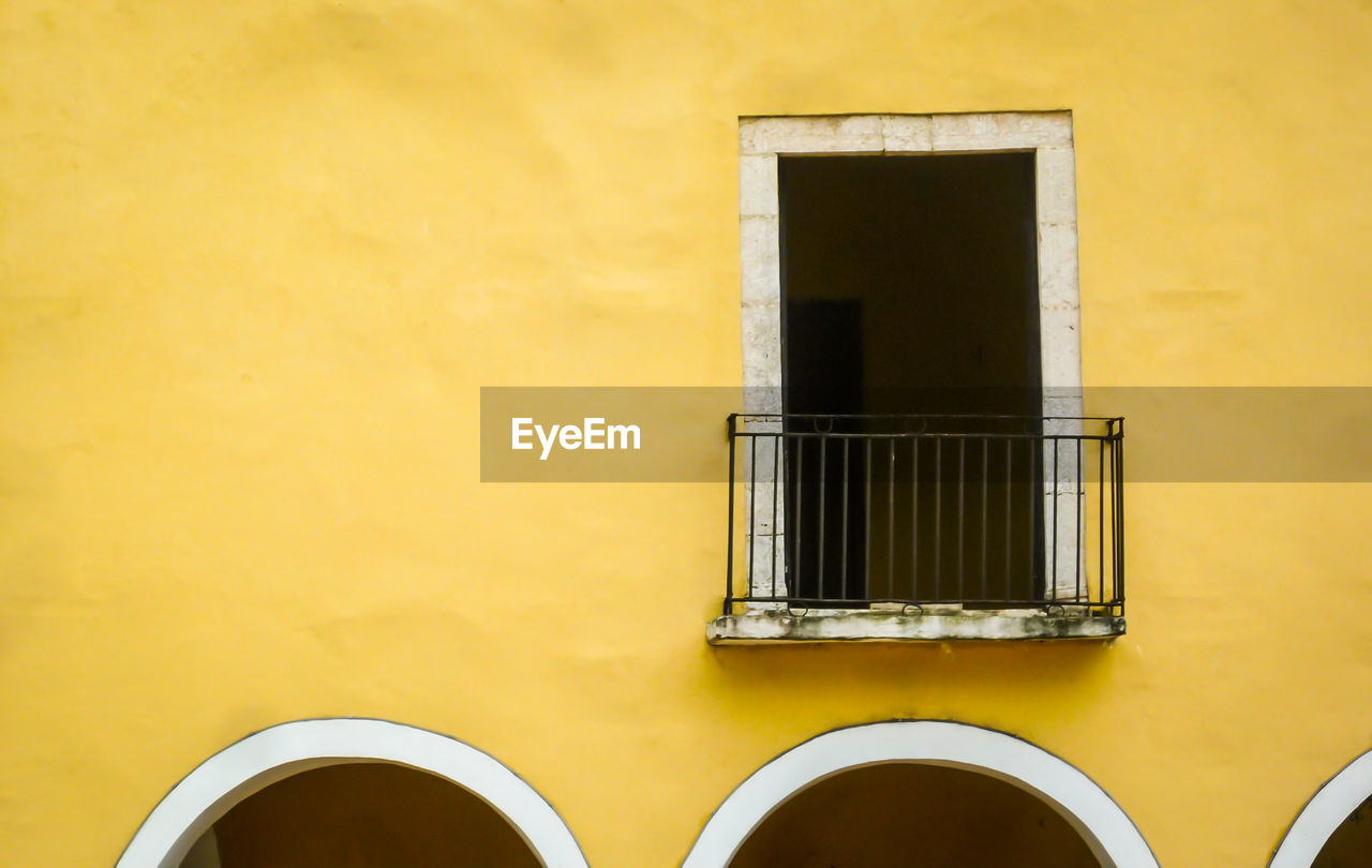 built structure, architecture, window, yellow, wall - building feature, building exterior, no people, building, metal, day, arch, close-up, wall, outdoors, house, old, geometric shape, low angle view, grate