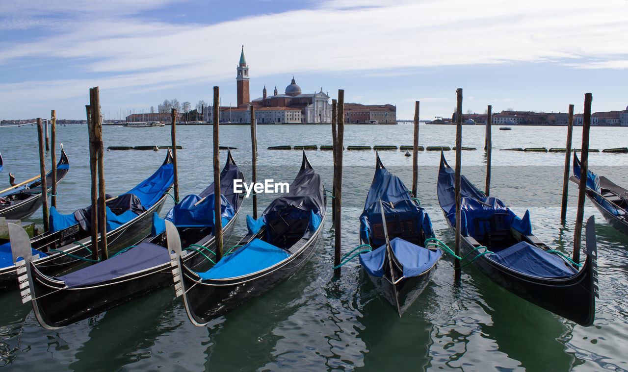 Gondolas Moored On Grand Canal With Church Of San Giorgio Maggiore In Background