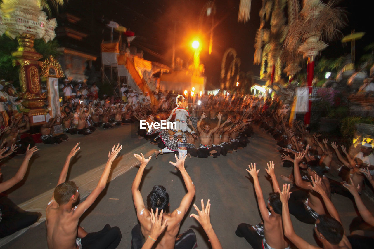 group of people, crowd, large group of people, real people, city, women, men, adult, lifestyles, street, night, enjoyment, leisure activity, celebration, togetherness, architecture, human arm, arts culture and entertainment, dancing, hand, arms raised, festival