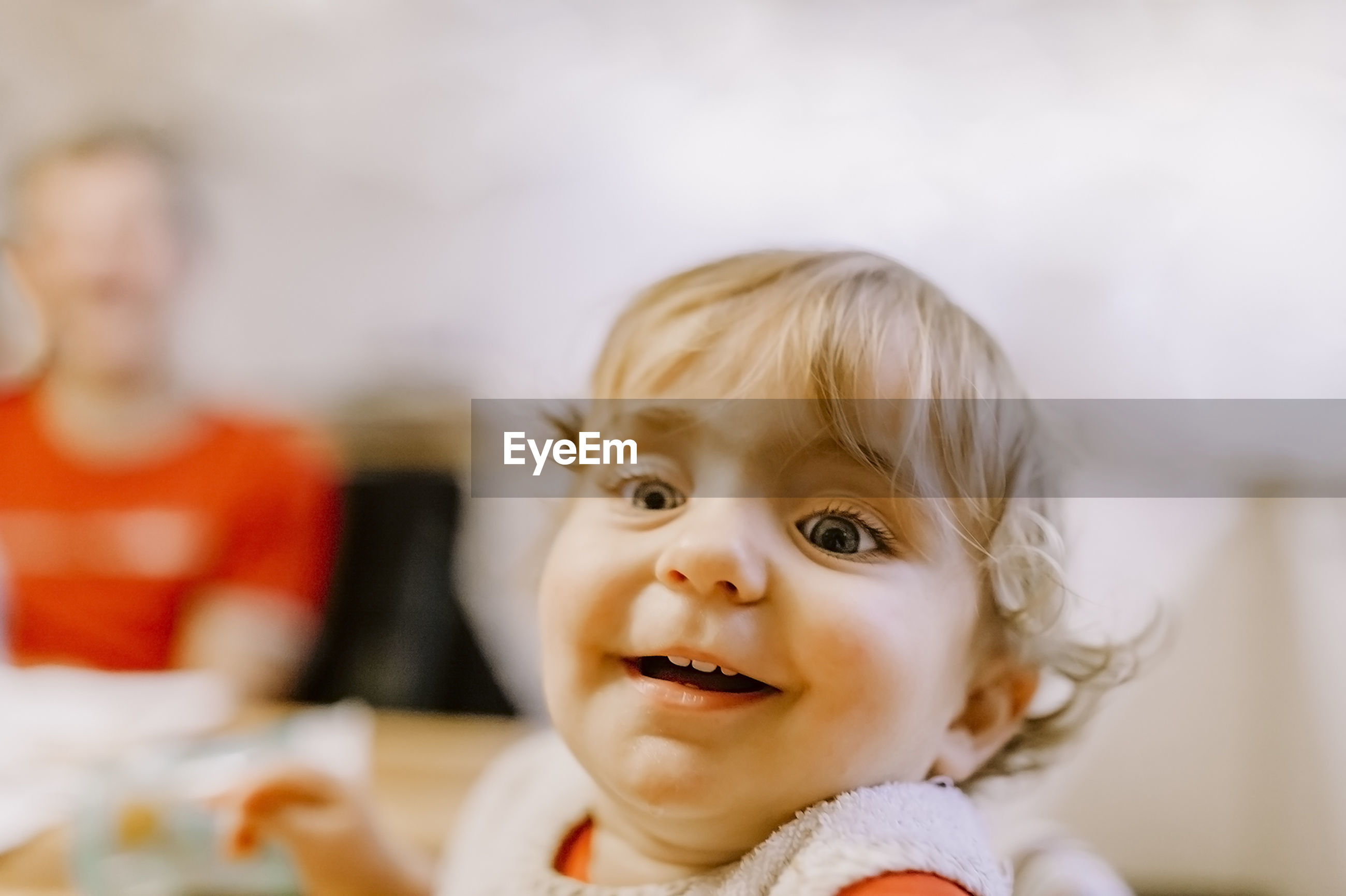 Close-up of cute smiling baby at home