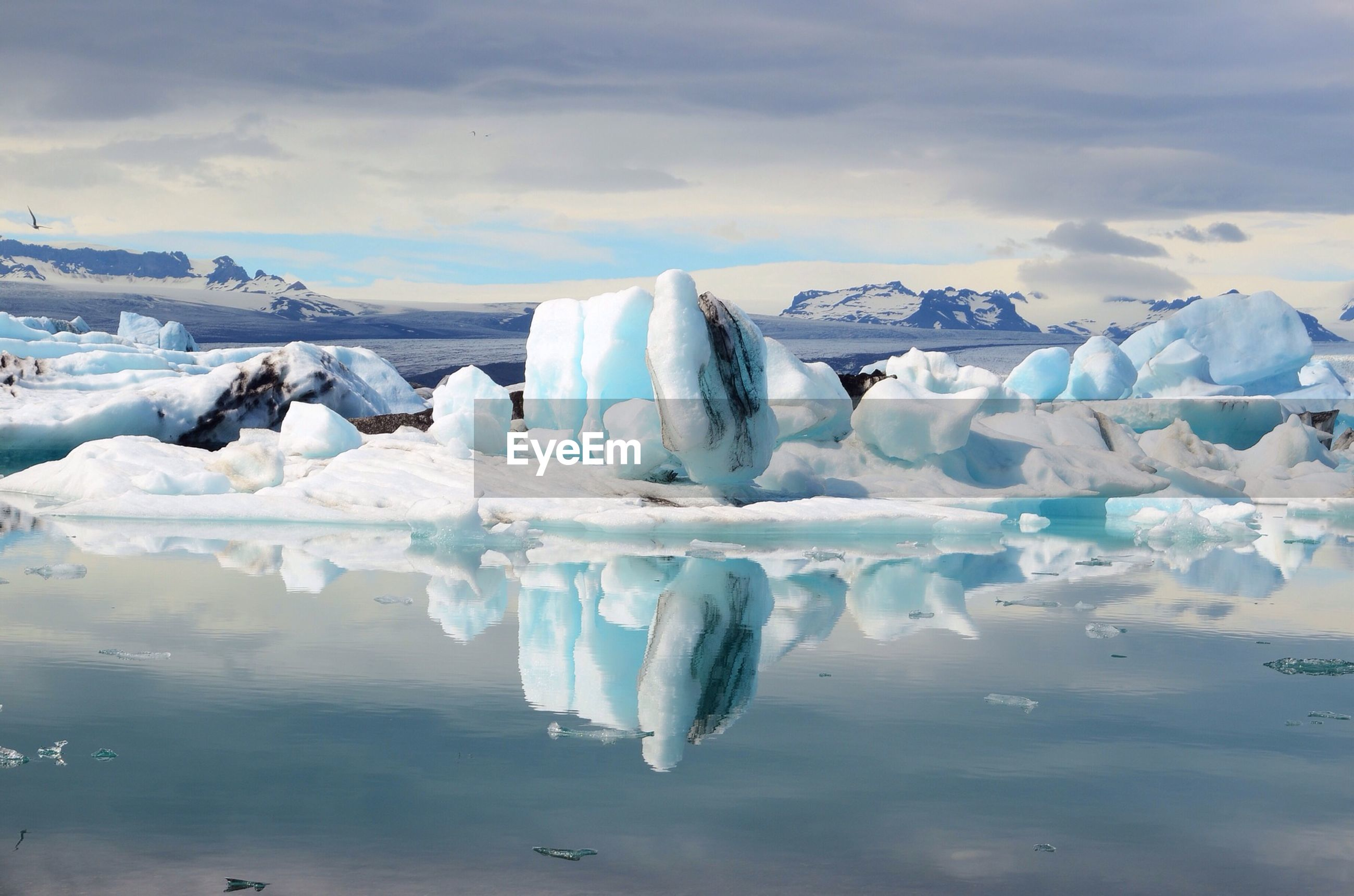 Reflection of iceberg in water