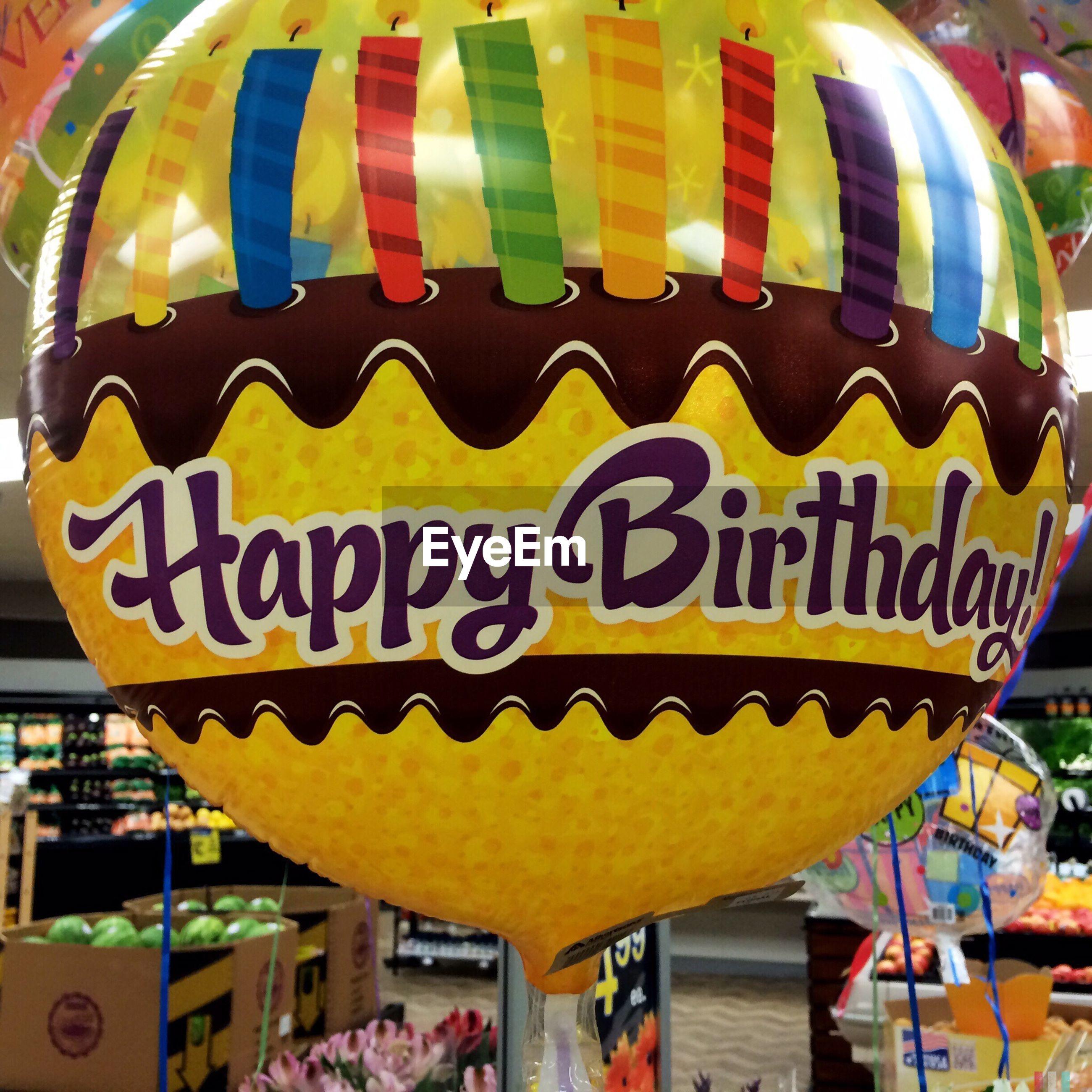 Text on balloon at market stall