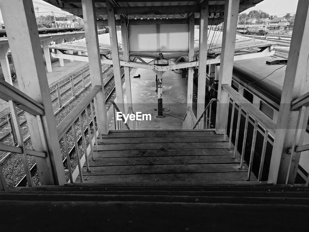 architecture, built structure, staircase, railing, steps and staircases, direction, building exterior, the way forward, building, day, one person, transportation, high angle view, real people, outdoors, unrecognizable person, metal, wood - material