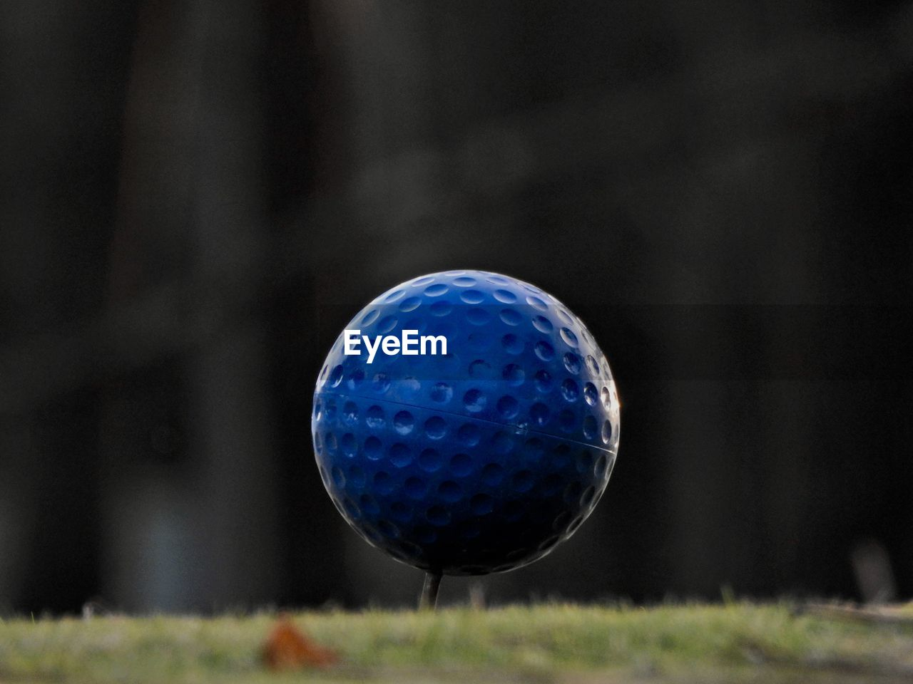 golf, golf ball, grass, activity, ball, close-up, leisure activity, focus on foreground, sport, no people, day, golf course, nature, outdoors, sphere, green color, plant, still life, selective focus, taking a shot - sport
