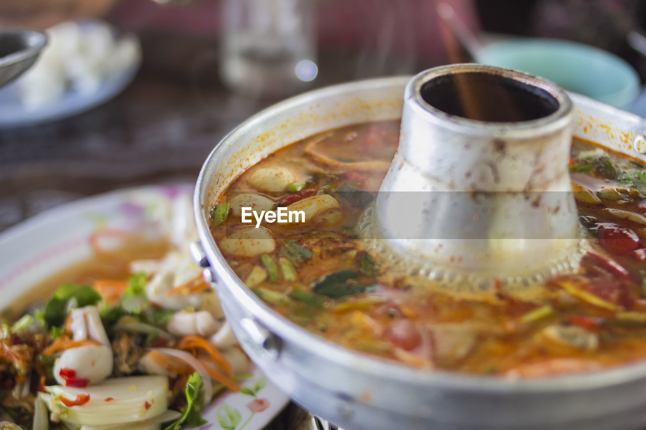 food and drink, food, ready-to-eat, freshness, healthy eating, still life, indoors, wellbeing, bowl, close-up, table, no people, selective focus, asian food, serving size, soup, vegetable, kitchen utensil, spoon, meal, temptation, crockery