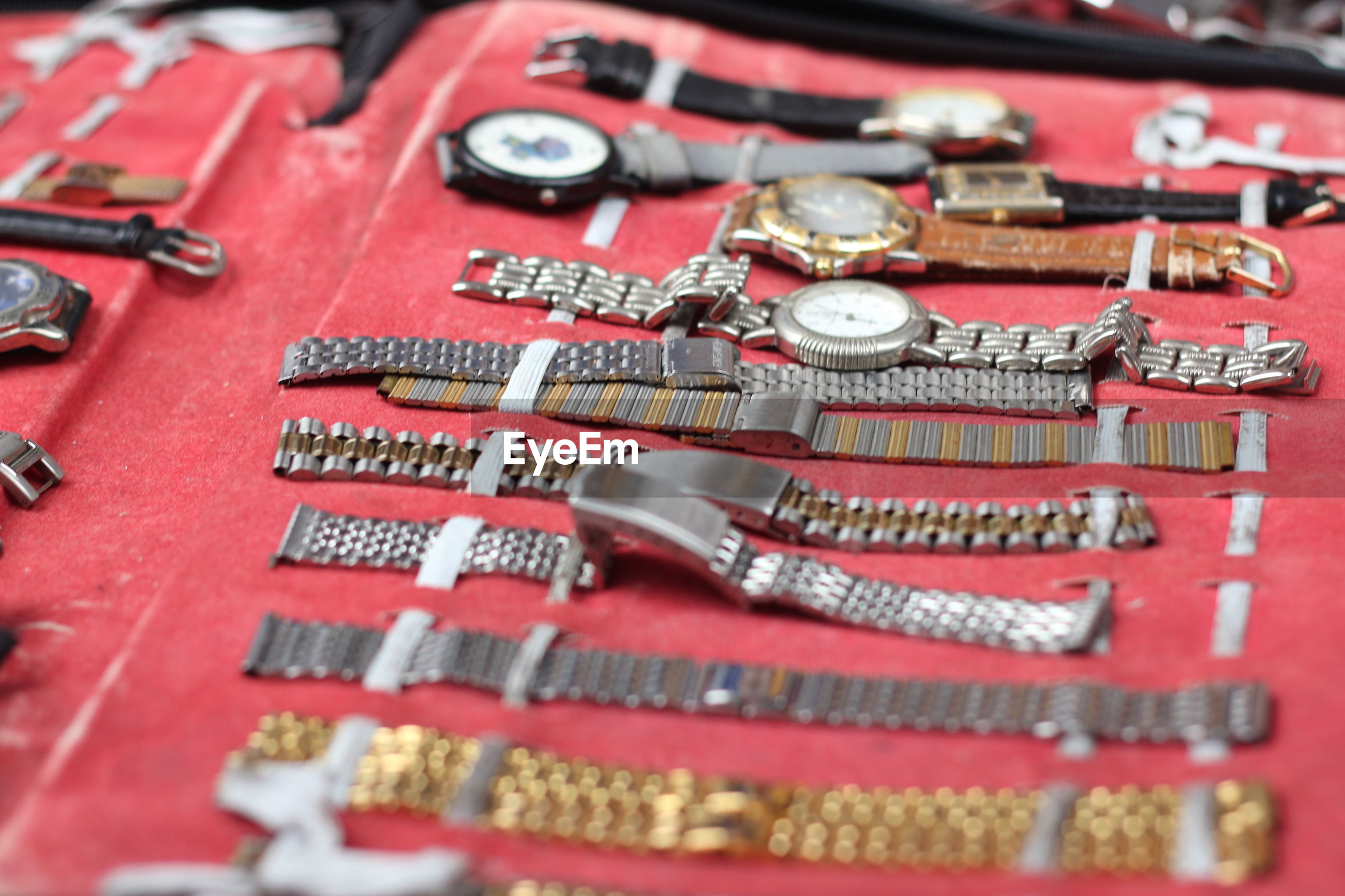 Close-up of wristwatches for sale in store