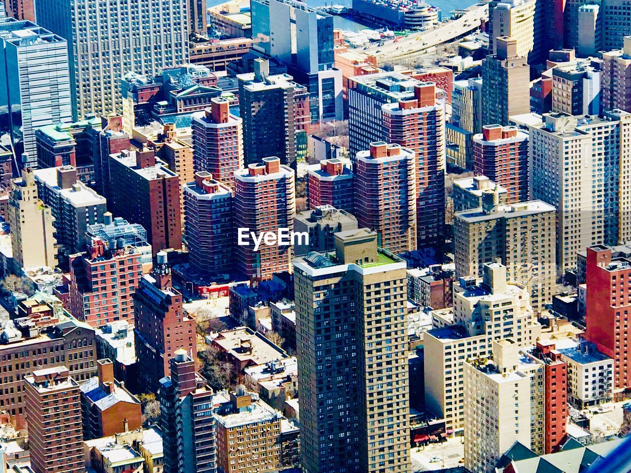 building exterior, architecture, building, built structure, city, office building exterior, skyscraper, cityscape, tall - high, modern, high angle view, tower, residential district, office, crowd, day, crowded, downtown district, city life, financial district, outdoors