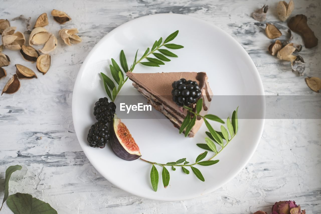 food, food and drink, freshness, table, still life, plate, high angle view, directly above, indoors, leaf, plant part, no people, indulgence, fruit, healthy eating, ready-to-eat, sweet food, dessert, temptation, sweet, herb, garnish, crockery