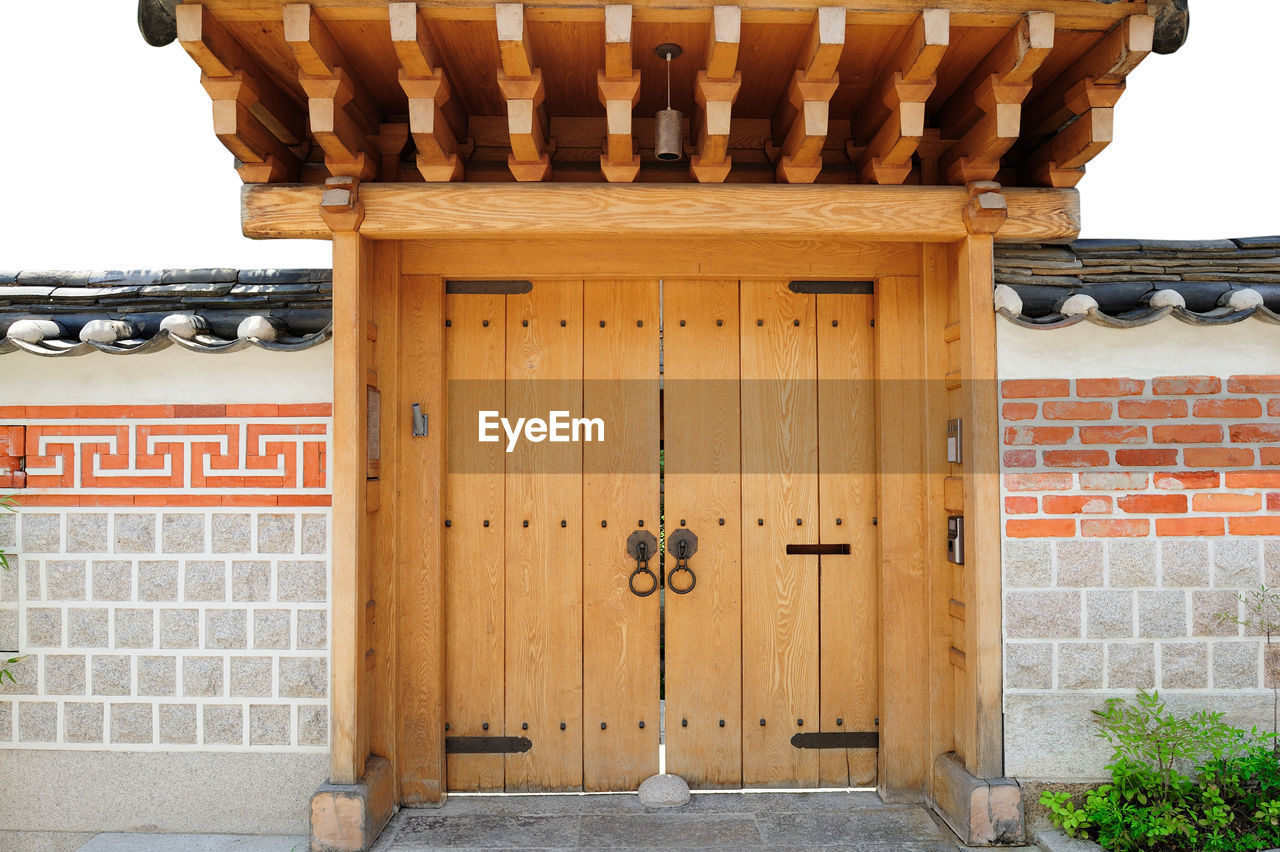 architecture, built structure, building exterior, wood - material, entrance, door, building, day, no people, house, security, closed, protection, wall - building feature, residential district, outdoors, brown, wall, safety, text