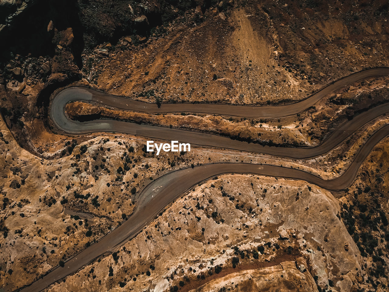 transportation, road, high angle view, landscape, aerial view, commercial land vehicle, mode of transport, curve, day, land vehicle, nature, scenics, winding road, outdoors, no people