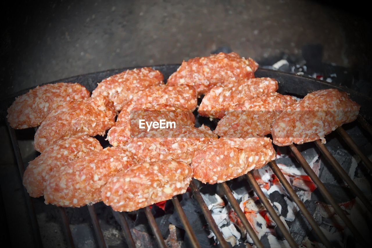 food, meat, freshness, food and drink, barbecue grill, preparation, barbecue, no people, close-up, high angle view, heat - temperature, grilled, still life, preparing food, focus on foreground, wellbeing, day, sausage, ready-to-eat, outdoors, snack