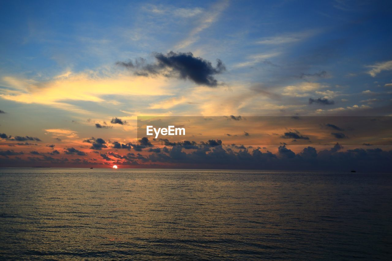 sunset, beauty in nature, scenics, tranquil scene, tranquility, sea, water, nature, idyllic, sky, no people, cloud - sky, rippled, waterfront, horizon over water, outdoors, day