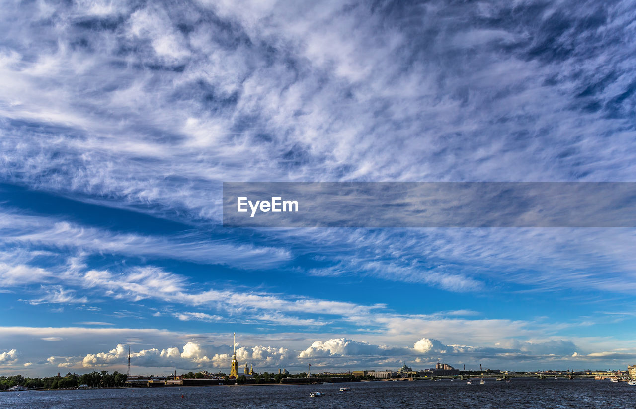 cloud - sky, sky, architecture, built structure, building exterior, nature, city, no people, beauty in nature, cityscape, landscape, building, scenics - nature, outdoors, environment, sea, day, water, blue, skyscraper, ominous