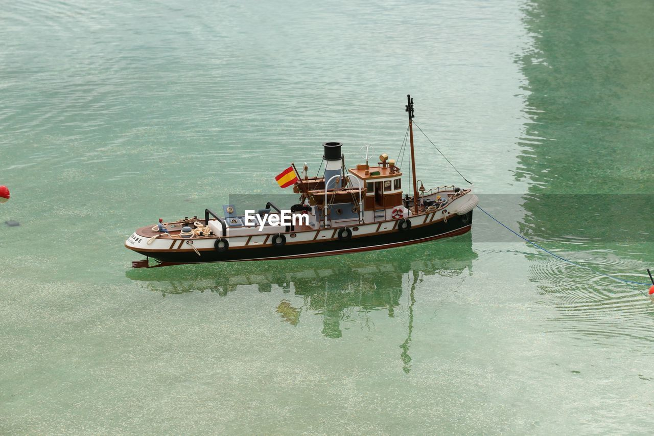 High angle view of spanish flag on boat moored over sea