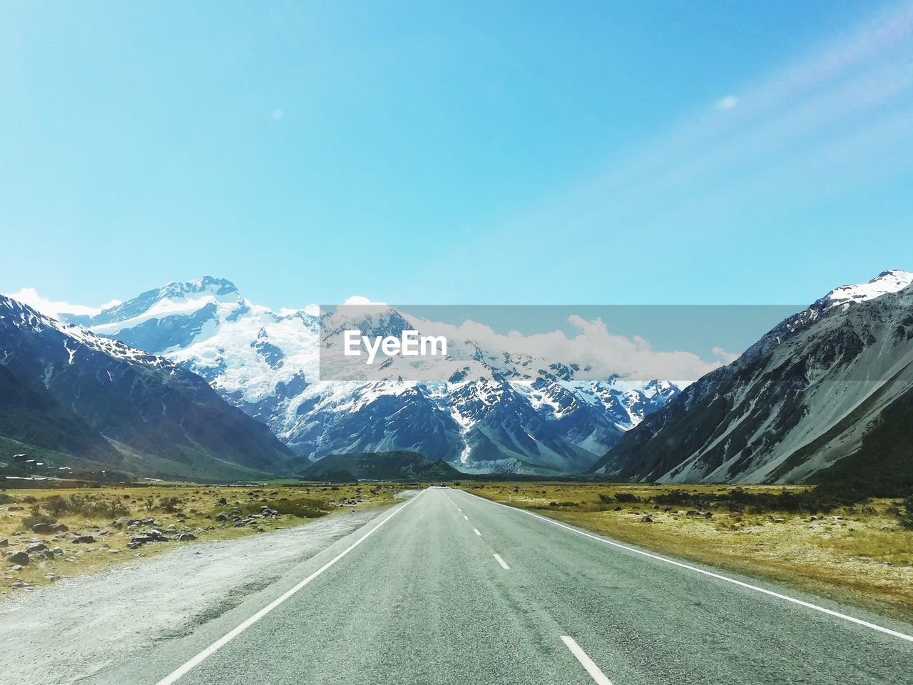 road, mountain, transportation, sky, direction, the way forward, scenics - nature, beauty in nature, environment, snow, landscape, non-urban scene, nature, cold temperature, tranquil scene, diminishing perspective, tranquility, no people, mountain range, snowcapped mountain, outdoors, dividing line