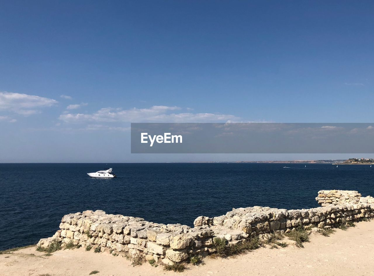 sea, water, sky, scenics - nature, beauty in nature, horizon, horizon over water, nature, tranquility, land, day, tranquil scene, no people, beach, sunlight, solid, rock, rock - object, idyllic