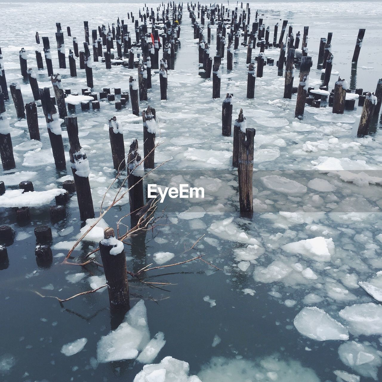 View of wooden post in sea at winter