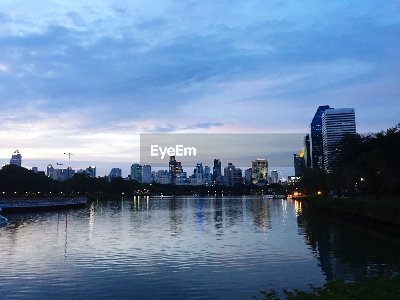 building exterior, architecture, city, built structure, water, sky, building, waterfront, cloud - sky, urban skyline, reflection, cityscape, nature, no people, office building exterior, landscape, river, skyscraper, sunset, outdoors, financial district