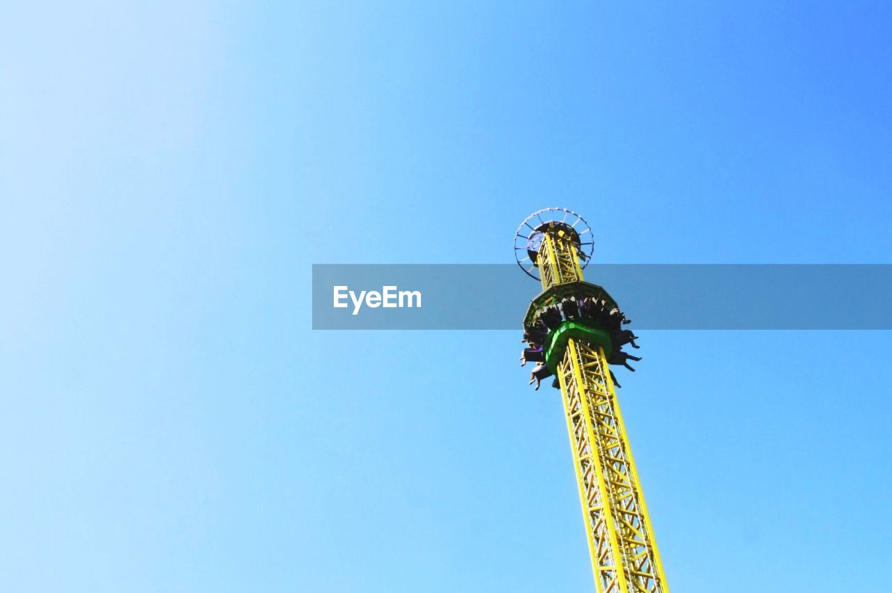 Drop tower ride against sky