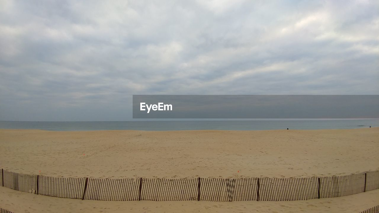 sky, sea, cloud - sky, beach, horizon over water, horizon, sand, land, water, beauty in nature, scenics - nature, tranquility, tranquil scene, nature, idyllic, day, wood - material, outdoors, no people