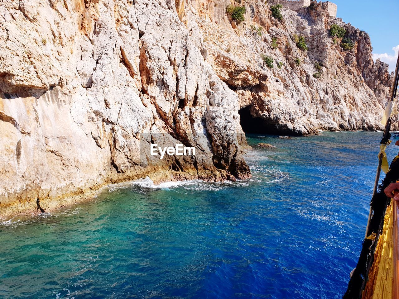 water, sea, rock, nature, beauty in nature, blue, rock - object, solid, no people, scenics - nature, land, tranquility, tranquil scene, rock formation, day, outdoors, cliff, idyllic, waterfront, formation, turquoise colored, eroded, rocky coastline