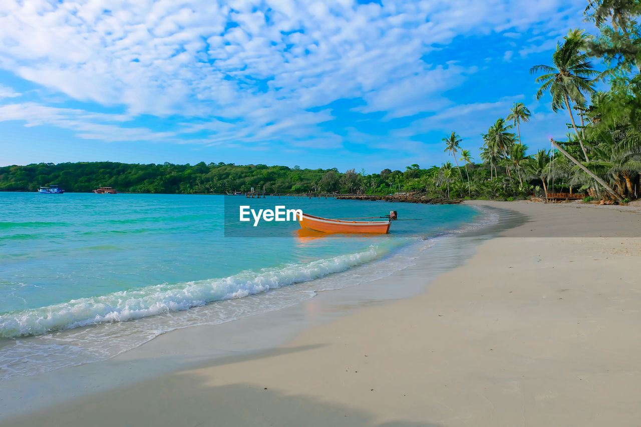 water, sea, beach, land, sky, cloud - sky, scenics - nature, beauty in nature, transportation, nautical vessel, nature, tree, sand, day, tranquility, tranquil scene, tropical climate, mode of transportation, plant, outdoors